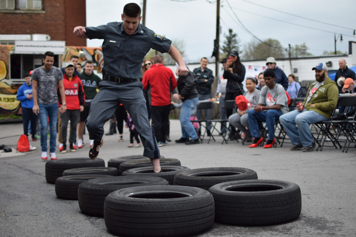 Trooper Dyllan O'Neil pumps his way through the tire run before the march.